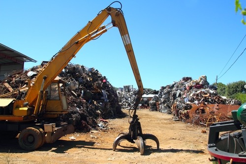 Should I take my car to a scrap yard or call a car removal company?